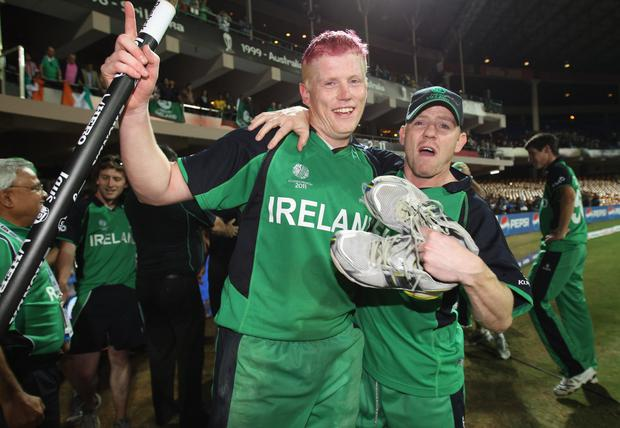 All smiles: Kevin and Niall O'Brien react to Ireland's stunning win and Kevin's sensational century