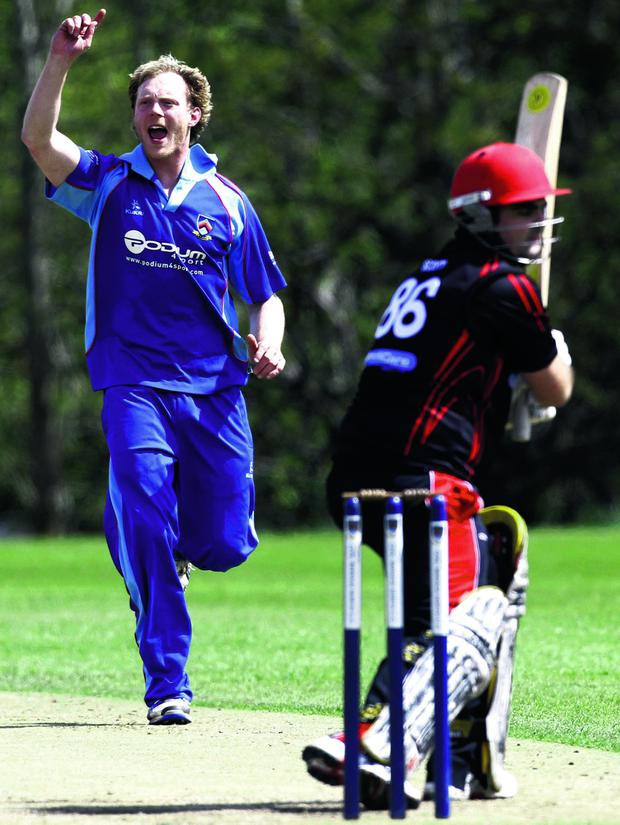 CSNI's bowler Alan Coulter celebrates taking the wicket of Strabane's batsman Barry Scott during Saturdays Round 1 RSA Irish Senior Cup game at Stormont.