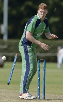 Kevin O'Brien watches as a wicket tumbles in Ireland's win over the Netherlands