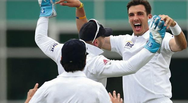 Steven Finn of England celebrates after taking the wicket of Ed Cowan of Australia during day one of the 1st Investec Ashes Test match between England and Australia at Trent Bridge Cricket Ground