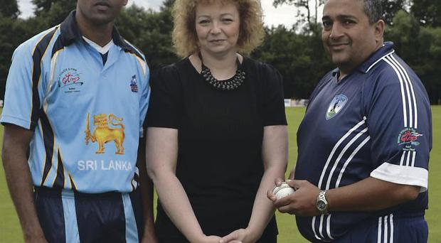 Stormont visit: Minister Carál Ní Chuilín with winning Sri Lankan captain Manoj Samarasekara (left) and NYPD's Mahaan Chandu