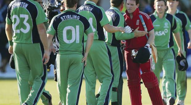 Friend or foe: Eoin Morgan is congratulated by his former Ireland team mates after leading England to victory in Dublin on Tuesday
