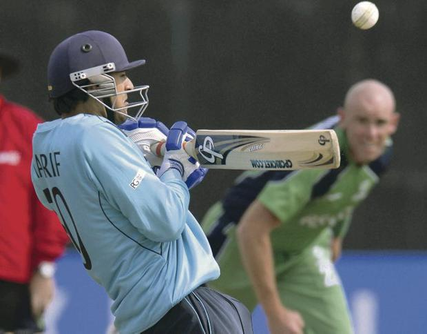 Under fire: Ireland's Trent Johnston bowls to Safyaan Sharif of Scotland at Stormont yesterday