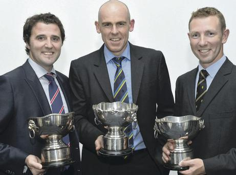 Prized possession: Kyle McCallan, Trent Johnston and Andrew White show off the awards from the Northern Cricket Union Dinner