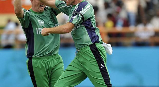 Trent Johnston (right) top-scored for Ireland