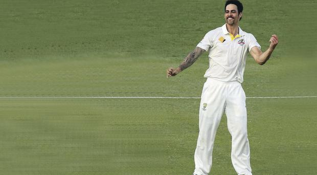 Got him: Australian bowler Mitchell Johnson celebrates taking the wicket of James Anderson, which clinched victory in the first Ashes test