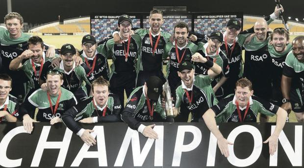 Ireland's players celebrate winning the trophy