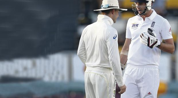 Heat of battle: Michael Clarke attempts to distract James Anderson