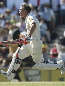 The delight on the face of Australian batsman David Warner is plain to see after he clocked up a century in the third Ashes Test in Perth