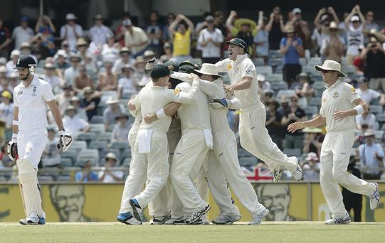 The Australia team celebrate the wicket of Jimmy Anderson which won the third Test in Perth
