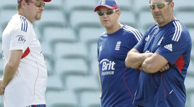 England coach Andy Flower flanked by bowling coach David Saker and batting coach Graham Gooch at practice