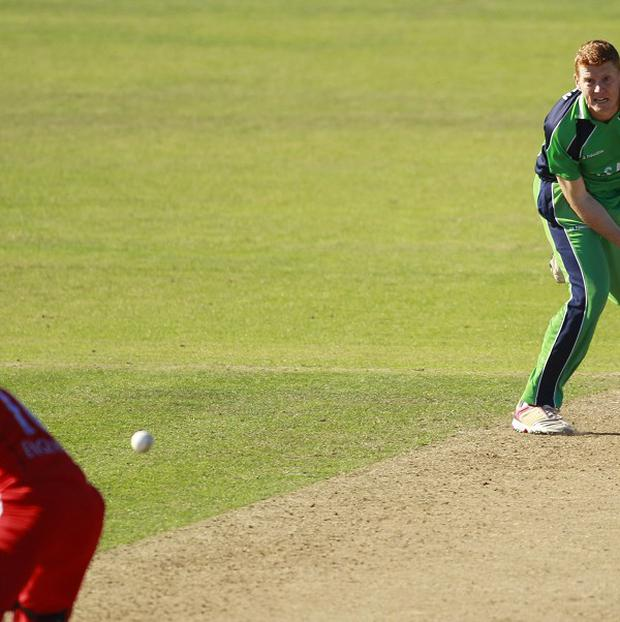Ireland's Kevin O'Brien, right, in action bowling against England's Eoin Morgan, left, during their One Day Cricket International at Malahide, Ireland. Changes proposed by the ICC could lead to the sides meeting in a Test match, according to Cricket Ireland's Warren Deutrom.