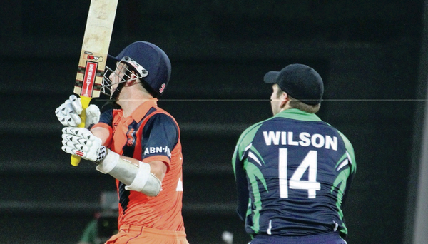 Just like that: Netherlands' batsman Tom Cooper smashes a six on the way to victory over Ireland
