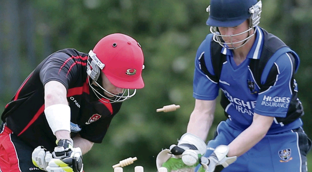 On his way: Strabane's Kevin Martin is helpless to prevent Stephen Hughes of CIYMS claiming his wicket on Saturday afternoon