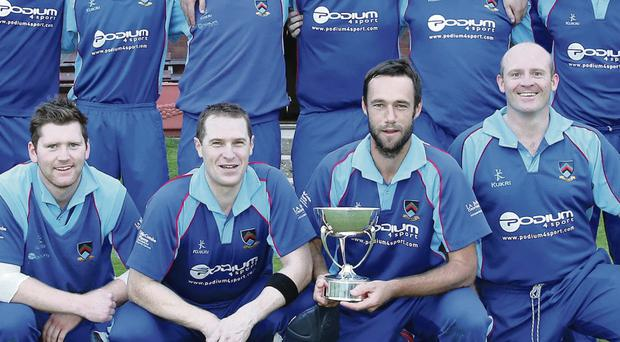 Silver Service: Civil Service North players celebrate their Twenty20 Cup win