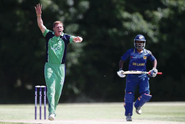 Got him: Ireland Craig Young claims the wicket of Sri Lanka A's Sachith Pathirana