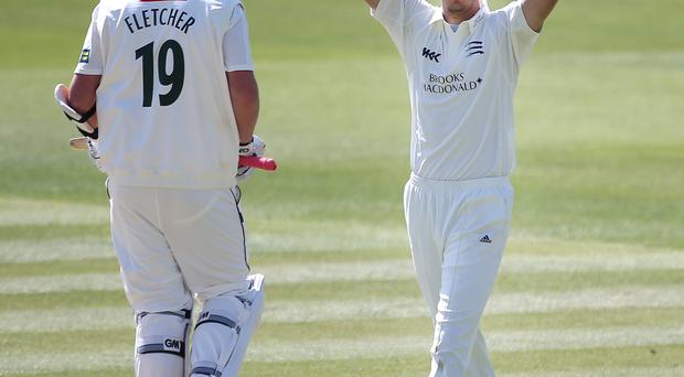 LONDON, ENGLAND - APRIL 16: Steven Finn of Middlesex celebrates after bowling out Luke Fletcher (R) of Nottinghamshire during day four of the LV County Championship match between Middlesex and Nottinghamshire at Lord's Cricket Ground on April 16, 2014 in London, England. (Photo by Charlie Crowhurst/Getty Images)