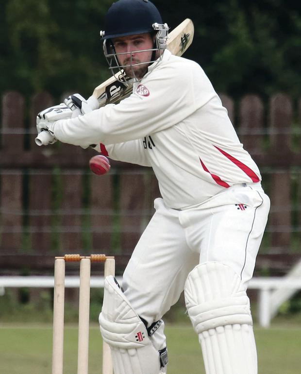 On the attack: Waringstown batsman James Hall smashed 81 in 56 balls against Lisburn yesterday