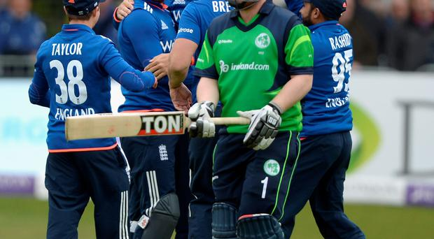 Got him: Paul Stirling trudges off after being run out as England players celebrate