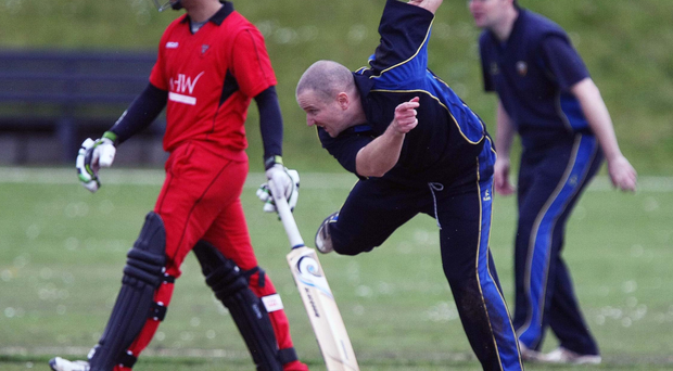 Bowled over: Woodvale's Johnny Burnside bowls in the Irish Senior Cup defeat against Leinster YMCA at Ballygomartin Road