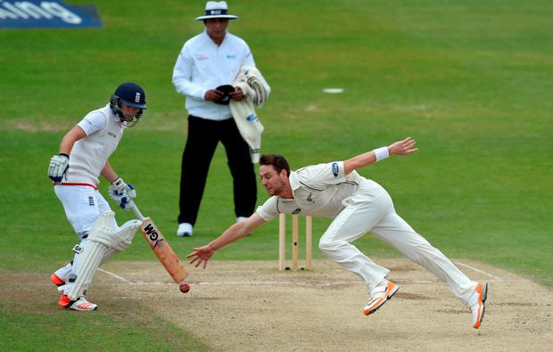 Long stretch: New Zealand bowler Matt Henry reaches for the ball as England's Adam Lyth makes sure he isn't run out