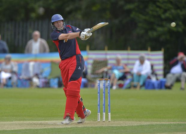 Big hit: Waringstown's Greg Thompson helped Ruhan Pretorius put on 154 in the last 10 overs in their Irish Cup triumph
