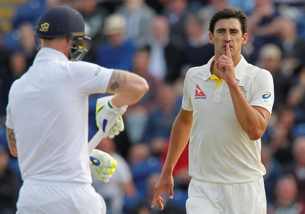 Quiet please: Mitchell Starc (left) advises Ben Stokes to keep it shut after dismissing him
