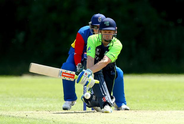 In the swing: William Porterfield hit 56 not out against Namibia