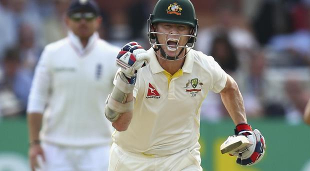 Triumph and toil: Chris Rogers celebrates after reaching his century