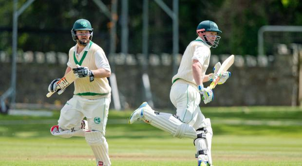 Running men: Paul Stirling (left) and William Porterfield are back together as Ireland's openers