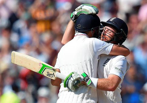 Team effort: Joe Root hugs Ian Bell after England took a 2-1 series lead in the Ashes