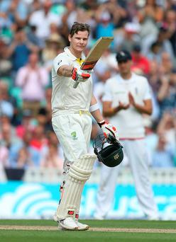 Australia's Steve Smith celebrates after reaching his century during day two of the Fifth Investec Ashes Test at The Kia Oval, London.