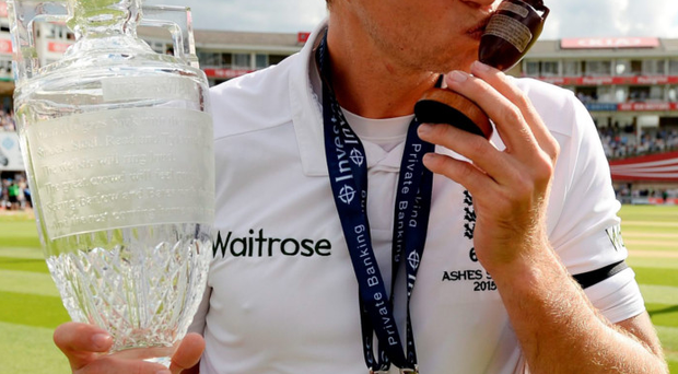 Champagne moment: Joe Root kisses the Ashes urn