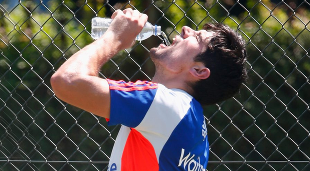 PIETERMARITZBURG, SOUTH AFRICA - DECEMBER 19: Alastair Cook of England has a drink as he cools down during nets and media access ahead of the tour match between South Africa A and England at City Oval on December 19, 2015 in Pietermaritzburg, South Africa. (Photo by Julian Finney/Getty Images)