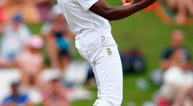 Seven-up: Kagiso Rabada of South Africa takes the wicket of Joe Root on his way to a seven-wicket haul