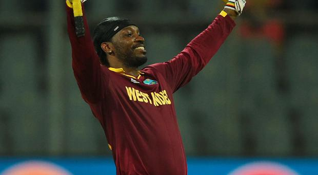 Ton up: Chris Gayle hails his 48-ball century against English
