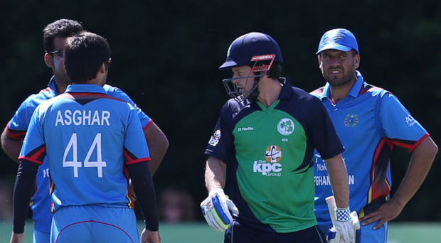 Hot topic: Ed Joyce discusses the taking of his wicket with opposing Afghanistan players