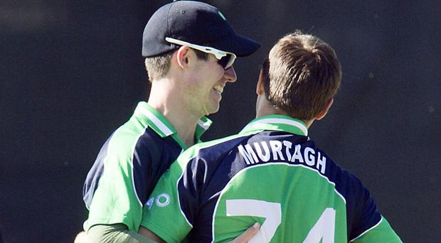 Tim Murtagh, right, took four wickets as Ireland secured victory