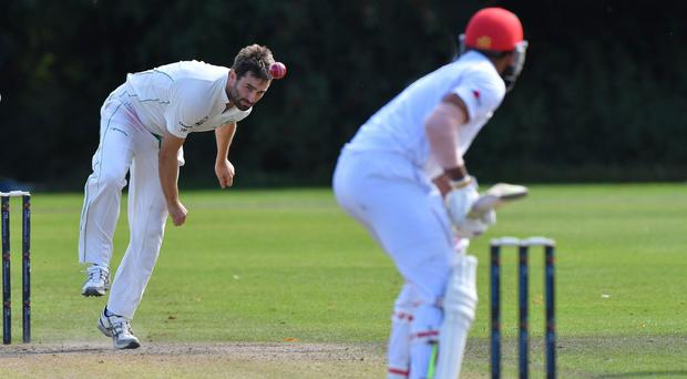 At the double: Tim Murtagh got two early wickets for Ireland at the start of Hong Kong's second innings at Stormont