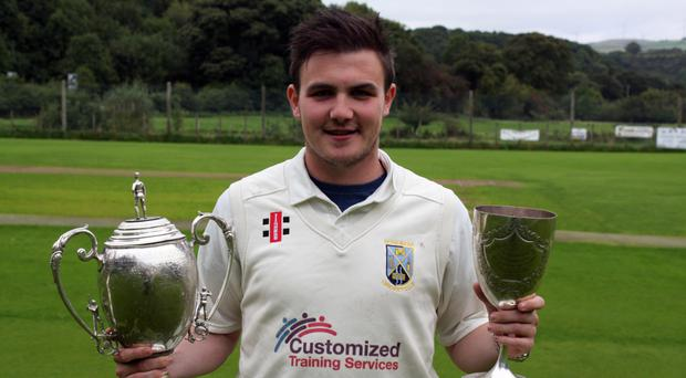 Champion: Captain Ricky-Dougherty with the Premiership and Senior Cup trophies after Donemana completed the double on Saturday