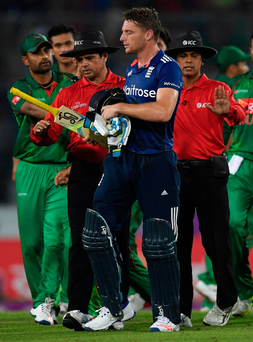 Temperature rising: Jos Buttler is ushered away by the umpires