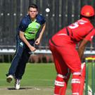 New cap: Jacob Mulder bowling in his first T20 international against Hong Kong
