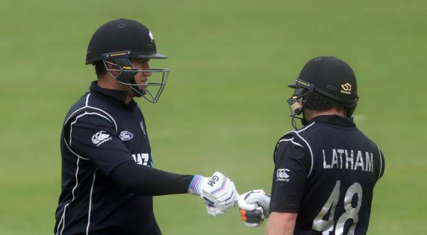 Tom Latham (right) led New Zealand to victory over Ireland