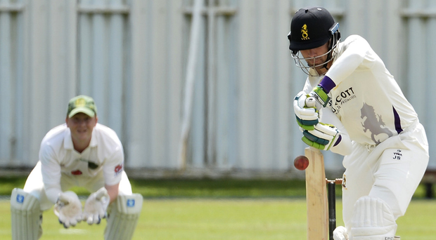 Up and down: James Shannon top scored for Instonians on Saturday in their Premier League defeat to North Down and was there at the finish as they beat Carrickfergus yesterday