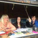 Count on us: Arlene Matchett, Helen McConaghy and Ann McCullough in the scorebox at this year's NCU Challenge Cup final