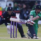 Ireland's William Porterfield, right, could not keep Afganistan at bay