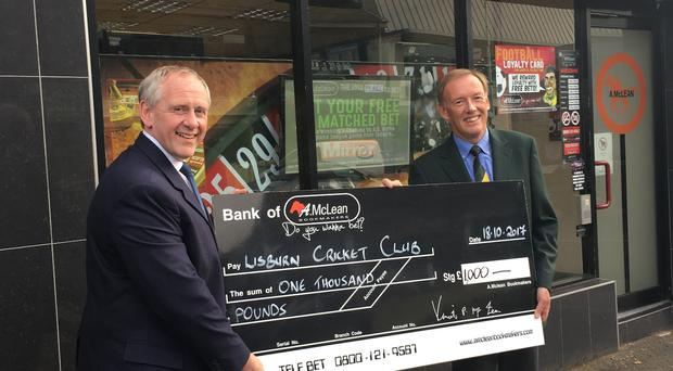 New deal: Paul McLean (left), MD of McLean Bookmakers, presents a cheque to Lisburn Cricket Club's Dean Simpson