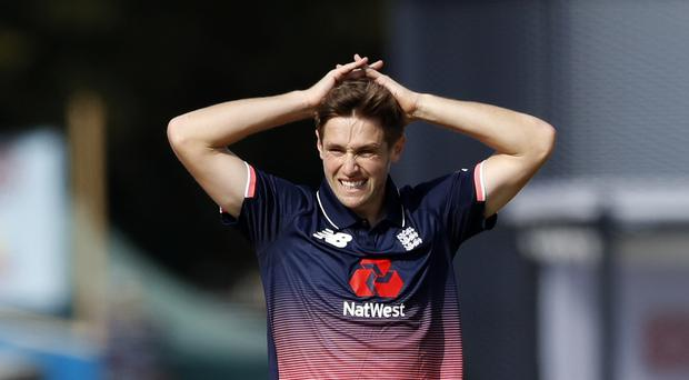 England's Chris Woakes top-scored with 78 as his side made 196 (Martin Rickett/PA)