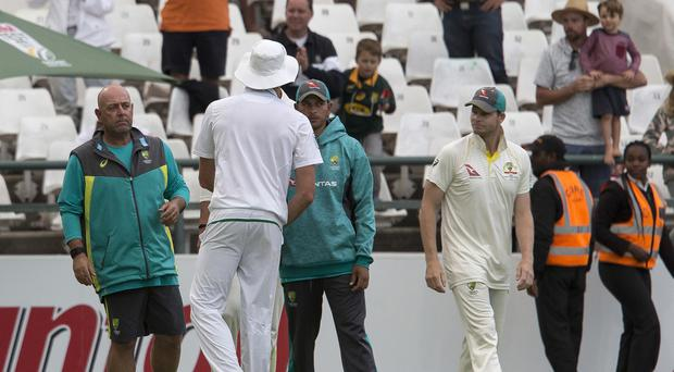 Steve Smith (right) stood down as captain as Australia were thrashed by South Africa in Cape Town