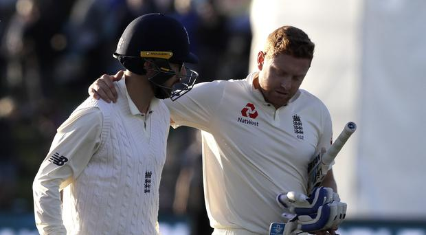 Jonny Bairstow (right) embraces Jack Leach at stumps on day one in Christchurch